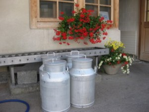 Milk churns outside Michel Beroud's dairy, Rougemont