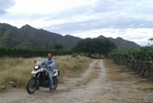 Arnaldo Etchart on his bike in the vineyards