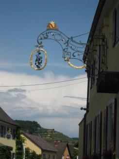 The Rebstock sign (right) and the Schwarzer Adler opposite
